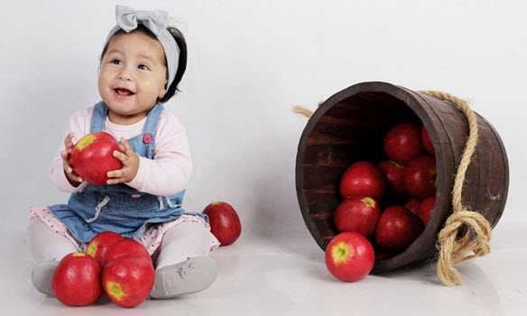 Baby Girl Eating Apple