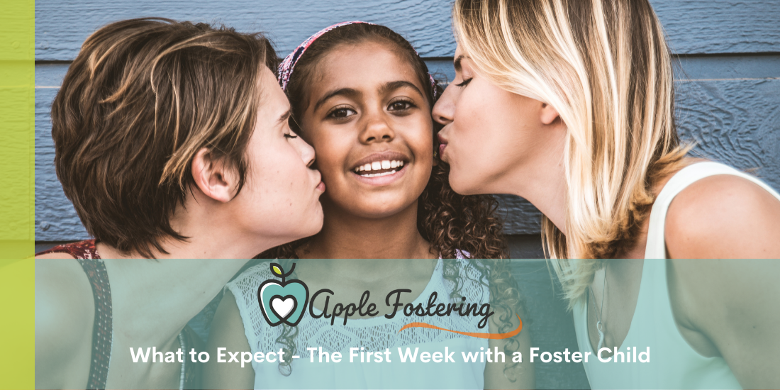 Foster family kissing young foster child