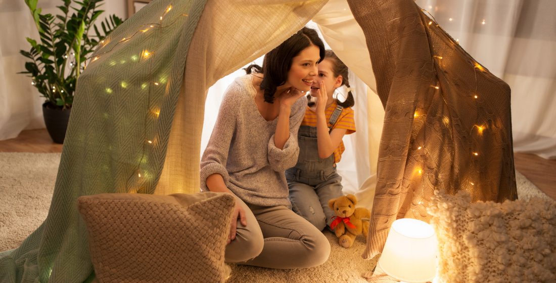 playing games in tent with child